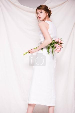 beautiful woman with lily flowers