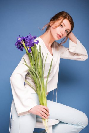 beautiful woman with iris flowers