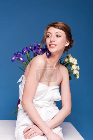 seductive young woman with flowers