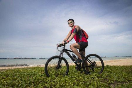 Asian Man riding on his bike