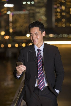 Chinese businessman using smartphone