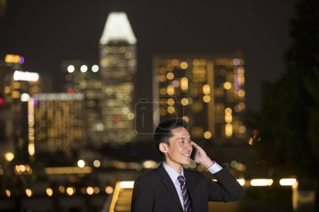Chinese businessman using smartphone