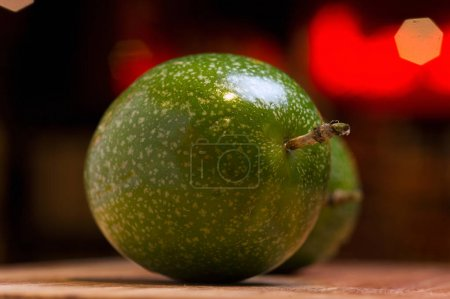 Exotic fruit of maracuja on wooden desk