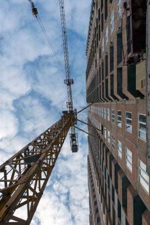 construction of buildings with construction crane