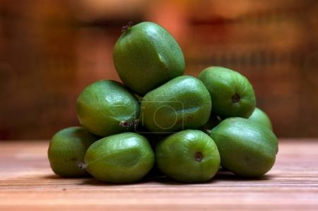 Exotic kiwi without lice on wooden desk