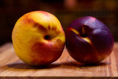 Exotic fruits of nectarine on wooden desk