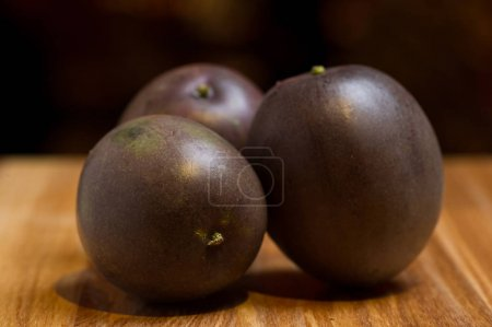 Exotic fruits of  maracuja on wooden desk
