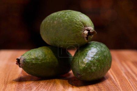 Exotic guava fruit on wooden desk