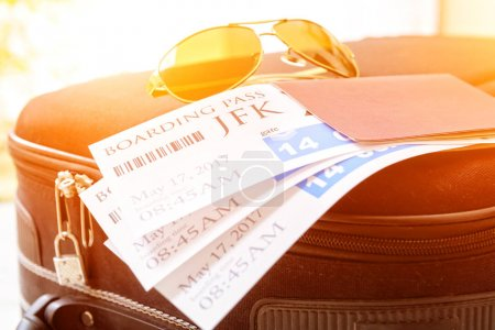 Boarding pass tickets and luggage