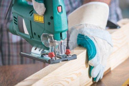Cutting a piece of wood using a jigsaw