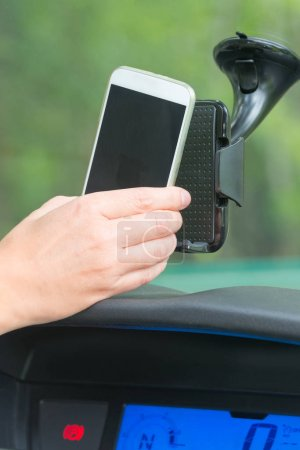 Inserting smart phone into the car holder