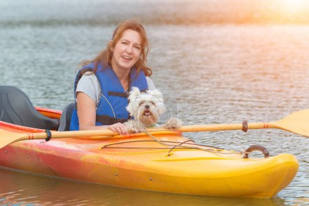 Woman and her dog on a kayak