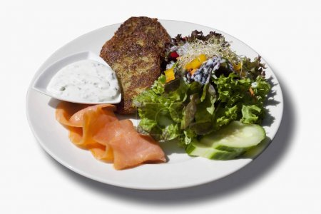 Potato fritters with smoked salmon, dip and a mixed salad
