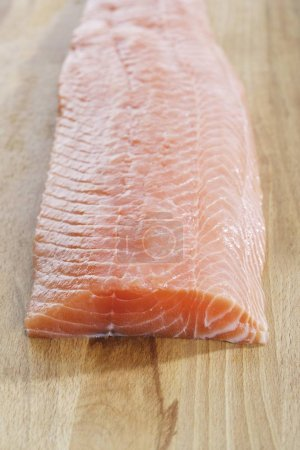 Salmon (Salmonidae) on wooden board