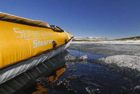 Side of a kayak reflected on a lake with ice floes, Sogn og Fjordane, Norway, Scandinavia, Europe