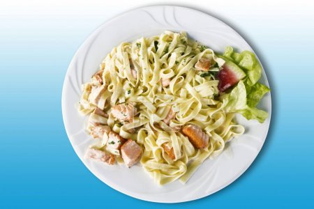Pasta in plate, tagliatelle with salmon