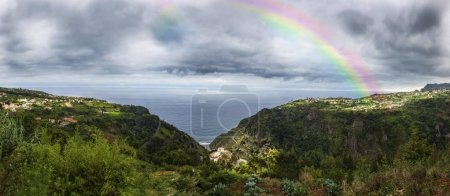 Rainbow above the cliffs at Arco de Sao Jorge