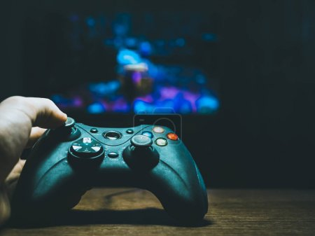 Photo for Close up of person holding gamepad and playing games - Royalty Free Image