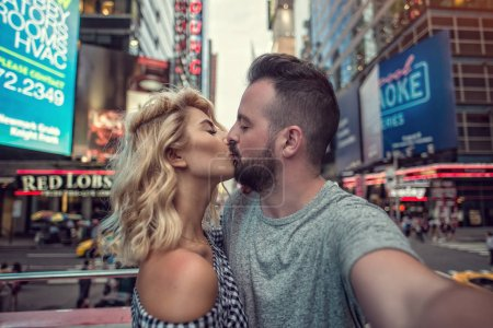 Times Square, August 2017, NYC:  Couple exploring New York City