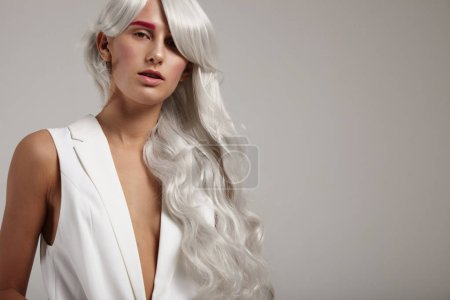 woman wears grey hair wig