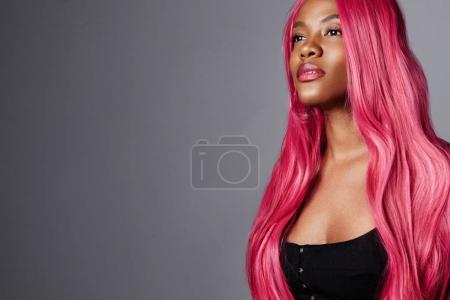 black woman with pink hair