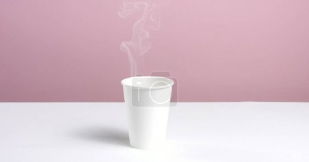 Pouring hot water into a paper cup