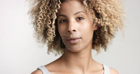 black woman with curly afro hiar portrait