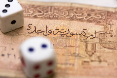 Photo for Close up view of Arabic paper banknote with cube - Royalty Free Image