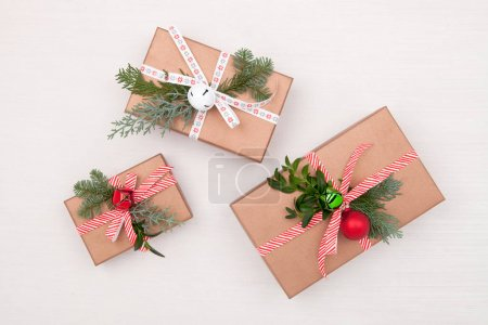 Christmas composition. Gifts, fir tree branches, jingle bells on