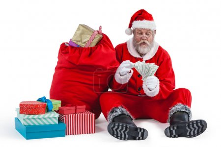 Santa claus sitting next to gift counting