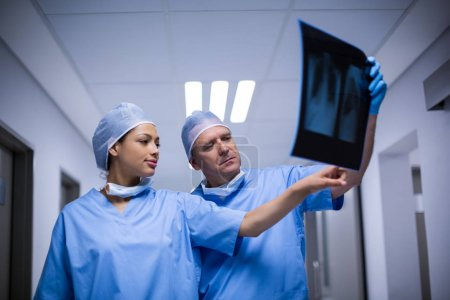 Surgeons discussing over x-ray