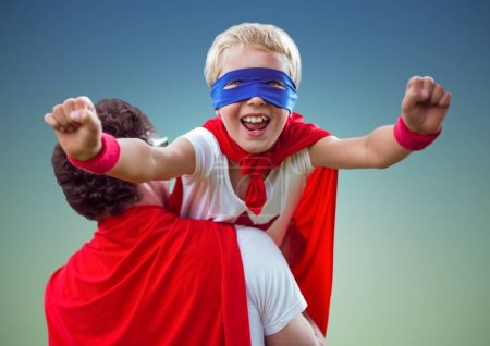 Father carrying son in super hero costume