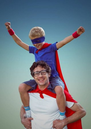 Happy father and son in red cape and mask having fun
