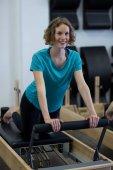 Cvičení na reformátora fit žena