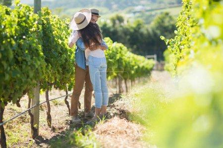 Young couple hugging at vineyard