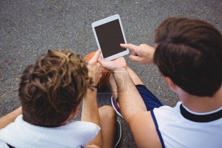 basketball players using digital tablet