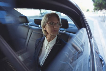 Thoughtful businesswoman in car