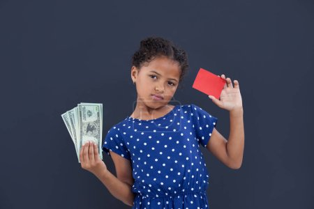 girl showing currency and credit card