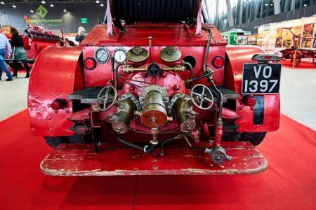 MOSCOW - MAR 09, 2018: Dennis (1929) fire truck at exhibition Oldtimer-Gallery in Sokolniki Exhibition Center. It is only one in Russia exhibition of vintage cars and technical antiques.