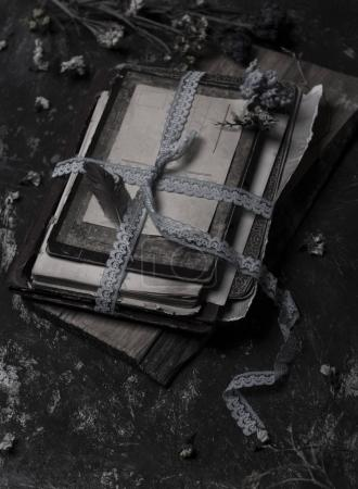 old books and letter closed with blue ribbon in vintage style
