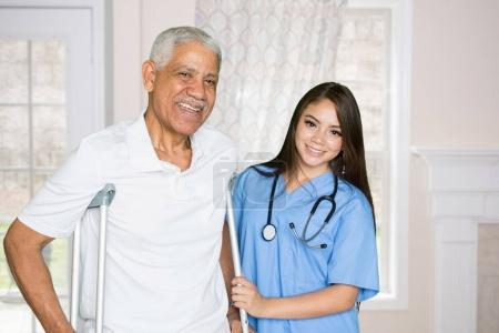 Photo for Nurse giving care to an elderly patient at home - Royalty Free Image