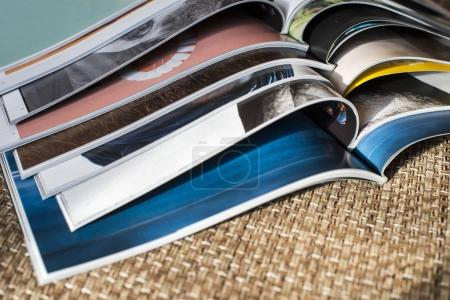 Many opened magazines