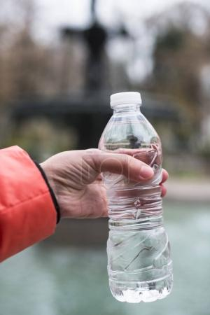 Hand hold bottle mineral water