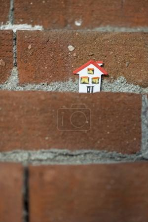 House miniature and brick wall