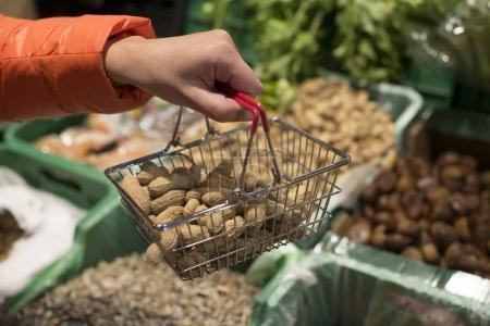 Buying peanuts in shop.