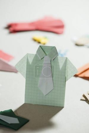 Shirt origami over  paper