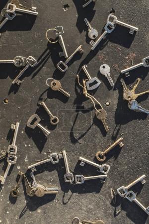 Multiple scattered keys on dark background
