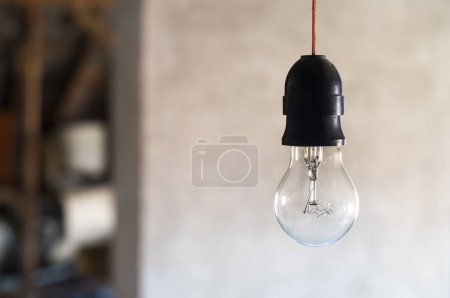 Old lamp bulb on background