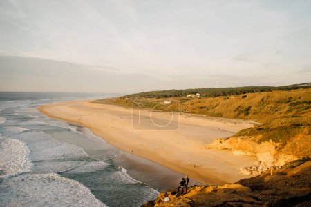 relaxing view of the beach at sunset in Portugal, Nazare