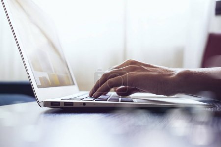 Photo for Young female hands typing on a laptop keyboard - Royalty Free Image